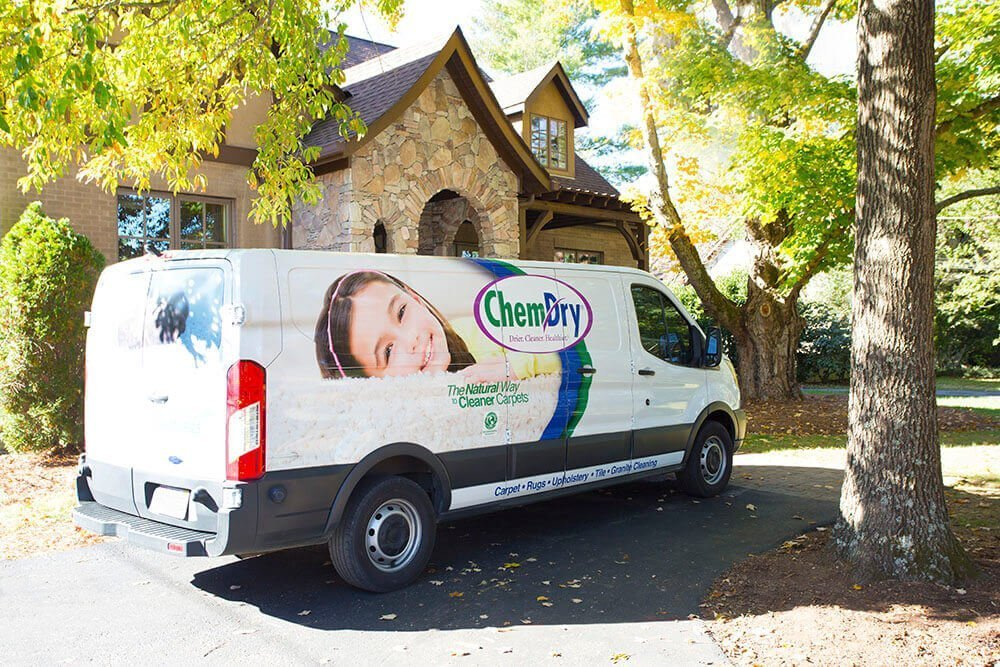 Chem Dry Greensboro van in front of house